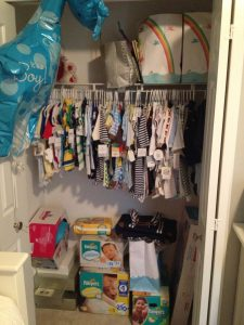 organising your baby storage unit with boxes and adding a rail in a wardrobe.