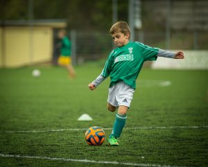 how to teach your child to love sport boy playing football