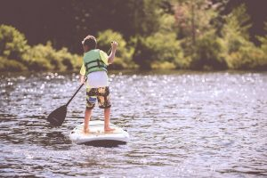 how to teach your child love sports boy paddle boarding