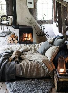 scandinavian secrets to a stylish home finland bedroom with log burner